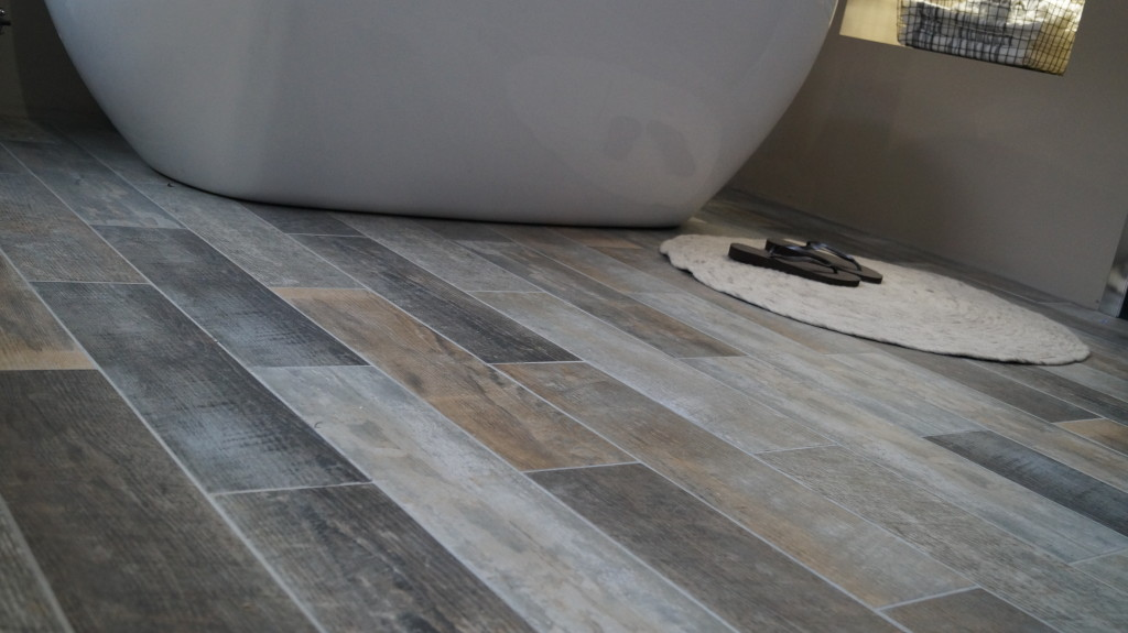 Get the natural look the latest bathroom trends for Latest floor tile trends